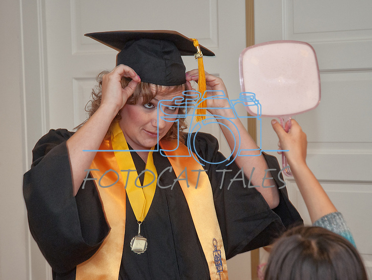Brittany Esposito makes final adjustments prior to commencement at the Western Nevada College in Fallon, Nev., on Tuesday, May 20, 2014. <br /> Photo by Kim Lamb