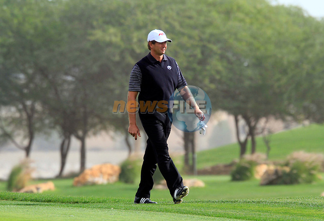 Retief Goosen (RSA) in action during the first round of .the Commercialbank Qatar Masters presented by Dolphin Energy played at Doha Golf Club, Doha, Qatar on 3rd February 2011..Picture: Phil Inglis / www.golffile.ie.