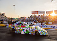 Sep 23, 2016; Madison, IL, USA; NHRA funny car driver Courtney Force (near) races alongside Tim Wilkerson during qualifying for the Midwest Nationals at Gateway Motorsports Park. Mandatory Credit: Mark J. Rebilas-USA TODAY Sports