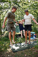Three generations of scouts. Camp in Camp in Tostarp by lake Finjasjön close to the city of Hässleholm. Three swedish scoutcorpses from Lund, Tyringe and Gothenburg arrange a camp to which 50 foreign scout joins everyday. The scouts this day comes från USA, UK, Czech Republic, Poland, and Germany and have mixed themselfs into new patrools. Photo: Magnus Fröderberg/Scouterna