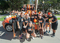 Women's basketball team. Homecoming gets kicked off with the traditional car parade through the quad, Thursday, Oct. 23, 2014. (Photo by Marc Campos, College Photographer)