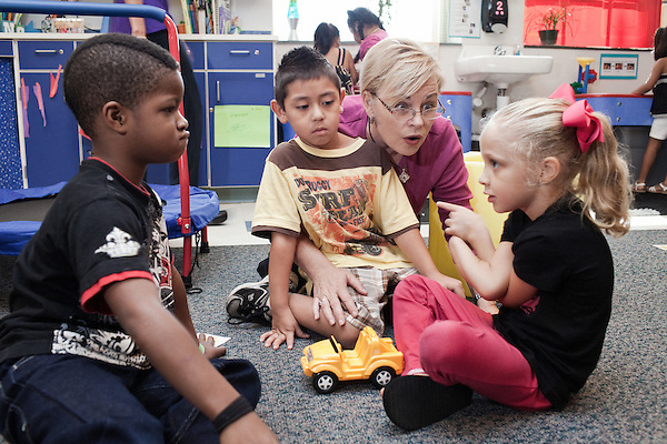 September 14, 2011. Raleigh, NC. . Gwenn Bolt, program coordinator for the pre school, helps out during activity time.. Project Enlightenment, a public pre-kindergarten program for at risk children, has been threatened with closure due to state wide budget cuts..
