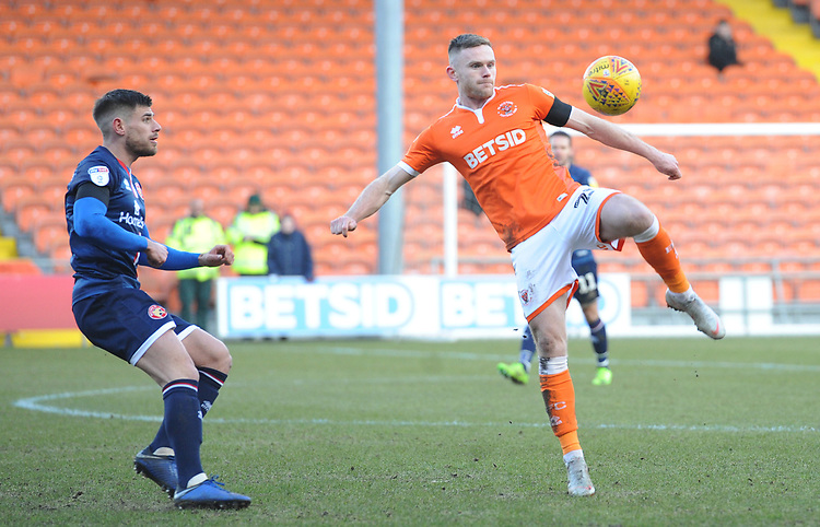 Blackpool's Oliver Turton under pressure from Walsall's Joe Edwards<br /> <br /> Photographer Kevin Barnes/CameraSport<br /> <br /> The EFL Sky Bet League One - Blackpool v Walsall - Saturday 9th February 2019 - Bloomfield Road - Blackpool<br /> <br /> World Copyright &copy; 2019 CameraSport. All rights reserved. 43 Linden Ave. Countesthorpe. Leicester. England. LE8 5PG - Tel: +44 (0) 116 277 4147 - admin@camerasport.com - www.camerasport.com