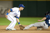 Round Rock Express second baseman Matt Kata #15 tags out the runner on an attempted stolen base during the Pacific Coast League baseball game against the New Orleans Zephyrs on April 30, 2012 at The Dell Diamond in Round Rock, Texas. The Zephyrs defeated the Express 5-3. (Andrew Woolley / Four Seam Images)..
