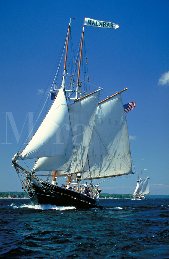 Twin-masted schooners owned by Traverse Tall Ships Company on West Grand Traverse Bay; Malabar operates as a Bed & Breakfast after evening cruises; Manitou sails on 3 & 6 day cruises from Northport. Traverse City Michigan USA downtown.