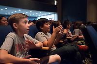 NWA Democrat-Gazette/ANTHONY REYES @NWATONYR<br /> Elementary students fro Rogers school district Tuesday, May 16, 2016 during a performance by the Arkansas Philharmonic Orchestra at Rogers High School auditorium. The students have been studying a music curriculum, &quot;The Orchestra Rocks.&quot; The students sang and played a recorder during parts of the performance with the orchestra.