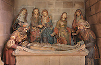 Polychrome sculpture of the Entombment, 16th century, Christ's body is surrounded by the Virgin with St John the Baptist, Mary Magdalene, the holy women and Nicodemus at the foot of the tomb, in the Collegiale Notre-Dame de Poissy, a catholic parish church founded c. 1016 by Robert the Pious and rebuilt 1130-60 in late Romanesque and early Gothic styles, in Poissy, Yvelines, France. The Collegiate Church of Our Lady of Poissy was listed as a Historic Monument in 1840. Picture by Manuel Cohen