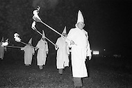 Dunham Springs, LA- December 11, 1976<br /> The members of the local Ku Klux Klan gather at a monthly evening ceremony. Wearing white hoods they circle their traditional cross on fire. <br /> Dunham Springs, Louisiane. 11 d&eacute;cembre 1976.<br /> Le Ku Klux Klan, m'a invit&eacute; &agrave; assister &agrave; la c&eacute;r&eacute;monie mensuelle o&ugrave; ils br&ucirc;lent une croix pour symboliser leur: &ldquo;Vigilance pour la protection de la race blanche.&ldquo;