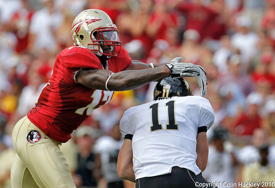 TALLAHASSEE, FL 9/25/10-FSU-WF FB10 CH-Florida State's Nigel Bradham lunges at Wake Forest's Tanner Price during first half action Saturday at Doak Campbell Stadium in Tallahassee. .COLIN HACKLEY PHOTO