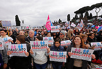 "Manifestazione ""Family Day"" al Circo Massimo, in sostegno della famiglia tradizionale, contro la legge sulle unioni civili in discussione al Senato, Roma, 30 gennaio 2016.<br /> Demonstrators hold signs reading ""Wrong is wrong"" at the Circus Maximus during the ""Family Day"" rally in support of traditional family, against civil unions proposed law in discussion at the Italian Parliament, Rome, 30 January 2016.<br /> UPDATE IMAGES PRESS/Riccardo De Luca"