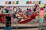29/07/2014. Kirkuk, Iraq. Kirkuk residents are seen on an amusement park ride at the Baba Gorgor Park in Kirkuk, Iraq.