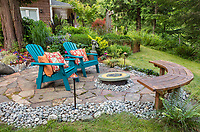 Whidbey Island, Washington: Patio space with colorful adirondack chairs in a quiet woodland garden setting