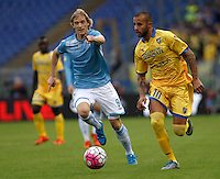 Calcio, Serie A: Lazio vs Frosinone. Roma, stadio Olimpico, 4 ottobre 2015.<br /> Lazio's Dusan Basta, right, and Frosinone's Danilo Soddimo run for the ball during the Italian Serie A football match between Lazio and Frosinone at Rome's Olympic stadium, 4 October 2015.<br /> UPDATE IMAGES PRESS/Isabella Bonotto