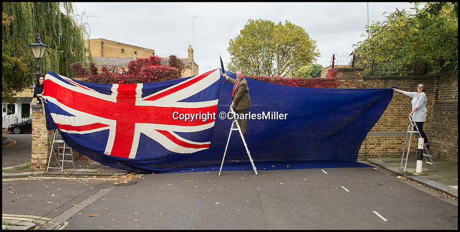 BNPS.co.uk (01202 558833)<br /> Pic CharlesMiller/BNPS<br /> <br /> Charles Miller and his staff try to unfurl the enormous flag.<br /> <br /> One of the largest flags in the world, that once graced the bow of the Queen Mary during WW2, is being sold by auctioneer Charles Miller in London.<br /> <br /> At 36 feet by 17, the huge blue ensign is the size of a double decker bus, and was flown by the famous liner when she served as a troopship during the war.<br /> <br /> The Queen Mary held the prestigious Blue Riband for the fastest Atlantic crossing from 1936 to 1952, and now is run as a hotel in Long Beach, California.