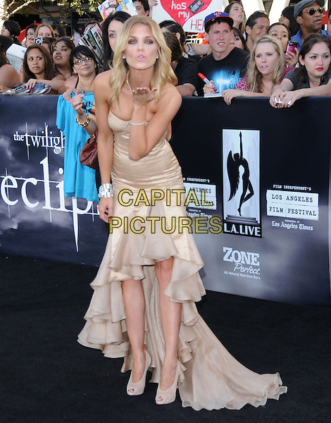 ANNALYNNE McCORD.The premiere of The Twilight Saga : Eclipse held at the Los Angeles Film Festival at Nokia Live in Los Angeles, California, USA..June 24th, 2010    .full length long maxi tiered ruffle dress ruffles peep toe cream shoes strapless beige hand blowing kiss.CAP/RKE/DVS.©DVS/RockinExposures/Capital Pictures.