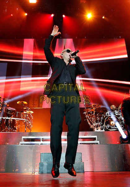 Pitbull ( Armando Perez )<br /> Rapper, songwriter, and record producer Pitbull, better known as Armando P&eacute;rez, performed at Aaron's Lakewood Amphitheatre in Atlanta, GA, USA, June 27, 2013.<br /> music performing live on stage in concert full length black suit sunglasses microphone singing arm raised up jumping <br /> CAP/ADM/DH<br /> &copy;Dan Harr/AdMedia/Capital Pictures