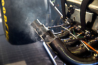Nov 1, 2015; Las Vegas, NV, USA; Detailed view as smoke comes from the header pipes on the engine of the car of NHRA top fuel driver Leah Pritchett during eliminations for the Toyota Nationals at The Strip at Las Vegas Motor Speedway. Mandatory Credit: Mark J. Rebilas-USA TODAY Sports