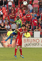 August 10, 2013: Seattle Sounders FC defender Djimi Traore #19 and Toronto FC midfielder Alvaro Rey #23 in action during an MLS regular season game between the Seattle Sounders and Toronto FC at BMO Field in Toronto, Ontario Canada.<br /> Seattle Sounders FC won 2-1.
