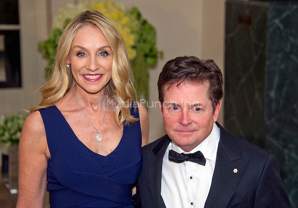 Actor Michael J. Fox, right, and Tracy Pollan, left, arrive for the State Dinner in honor of Prime Minister Trudeau and Mrs. Sophie Gr&Egrave;goire Trudeau of Canada at the White House in Washington, DC on Thursday, March 10, 2016.<br /> Credit: Ron Sachs / Pool via CNP/MediaPunch