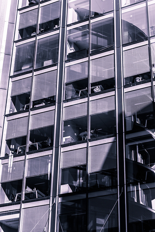 Office block windows in London with blinds