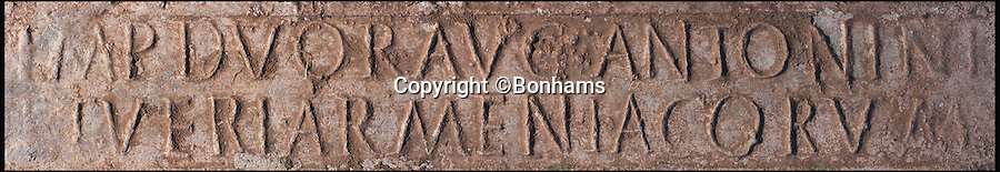 BNPS.co.uk (01202 558833)<br /> Pic: Bonhams/BNPS<br /> <br /> A treasure hunter who unearthed a 2,000-year-old Roman ingot on a farm is now set to sell it £60,000. <br /> <br /> Jason Baker found the 2ft long lead bar using his metal detector on a routine rally in the Mendip Hills near Wells, Somerset, earlier this year.<br /> <br /> The stunning 85lb ingot, which is inscribed with the name of emperor Marcus Aurelius Armeniacus and dates to 164 AD, is not regarded as treasure and so Jason is allowed to sell it at auction.