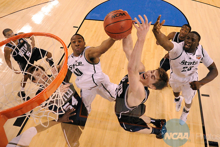 3 APR 2010: Gordon Hayward (20) of Butler and Delvon Roe (10) form Michigan State battle for control of a rebound during the semi final game of the Men's Final Four Basketball Championships held at Lucas Oil Stadium in Indianapolis, IN. Butler University went on to defeat Michigan State University 52-50 to advance to the championship game. Chris Steppig/NCAA Photos