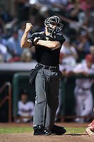 Umpire Justin Houser makes a call during a game between the Batavia Muckdogs and Tri-City ValleyCats on August 2, 2014 at Joseph L. Bruno Stadium in Troy, New York.  Tri-City defeated Batavia 8-4.  (Mike Janes/Four Seam Images)