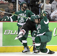 UNO's Rich Purslow gets caught between Bemidji State's Ian Lowe (No. 22) and Brad Hunt during the third period. Bemidji State beat UNO 4-2 Friday night during the first round of the WCHA playoffs at Qwest Center Omaha. (Photo by Michelle Bishop)