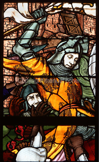 St Joan of Arc arrested by soldiers in Compiegne, 23rd May 1430, from a series of 19th century stained glass windows by Galland and Gibelin illustrating the life of Joan of Arc, in Orleans Cathedral, or the Basilique Cathedrale Sainte-Croix d'Orleans, built in Gothic style 1278-1329 and largely rebuilt 1601-1829 after it was partially destroyed in 1568, in Orleans, Loiret, Centre, France. The cathedral is listed as a historic monument. Picture by Manuel Cohen