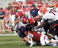 NWA Democrat-Gazette/ANDY SHUPE<br /> Arkansas' Mitchell Loewen (bottom), and Dre Greenlaw (center) tackle University of Texas at El Paso's Jeremiah Laufasa Saturday, Sept. 5, 2015, during the fourth quarter of play in Razorback Stadium in Fayetteville. Visit nwadg.com/photos to see more from the game.