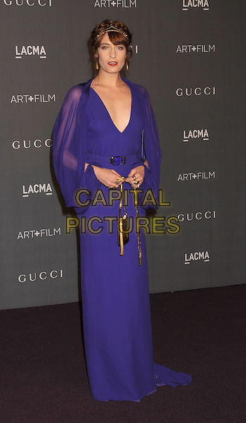Florence Welch of Florence & The Machine.at The LACMA 2012 Art and Film Gala held at LACMA in Los Angeles, California, USA, October 27th 2012..full length   maxi sleeve dress purple gold headdress necklace fringe v-neck sheer belt bag.CAP/ROT/TM.© TM/Roth/Capital Pictures