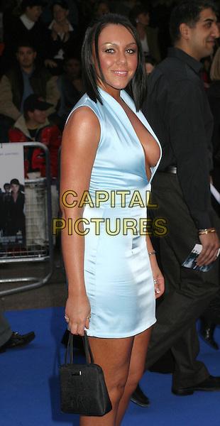 MICHELLE HEATON - LIBERTY X.X-Men 2 Film Preniere at Odeon West End.www.capitalpictures.com.sales@capitalpictures.com.©Capital Pictures.tanned, plunging neckline, tight fitting blue satin dress.