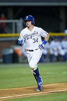Chris DeVito (34) of the Burlington Royals jogs towards home plate after hitting a home run against the Princeton Rays at Burlington Athletic Stadium on June 24, 2016 in Burlington, North Carolina.  The Rays defeated the Royals 16-2.  (Brian Westerholt/Four Seam Images)