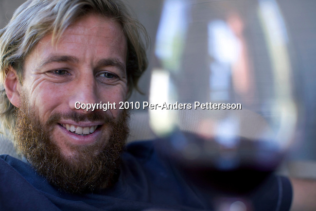 SOMERSET WEST, SOUTH AFRICA - MARCH 23: Pieter H. Waiser, the founder of Blank Bottle wine company, samples a new wine blend in his office on March 23, 2010 in Somerset West, South Africa. Mr. Waiser buys bulk wine from different wineyards around Cape Town and mixes his own blends. He doesn't own a wine farm himself and operates from a small office on a farm. (Photo by Per-Anders Pettersson/Getty Images)