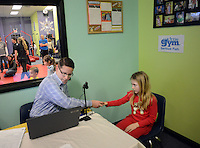 WARRINGTON, PA. - JANUARY 24: Thomas J. Arters of New York Life takes fingerprints from Marielle Trumbo, 8, of Warrington, Pennsylvania during an open house at The Little Gym January 24, 2015 in Warrington, Pennsylvania. New York Life created Child Fingerprint ID cards for all in attendance. The Child ID's include a child's photo, digitally-scanned fingerprints, and emergency contact information. (Photo by William Thomas Cain/Cain Images)