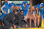 LOS ANGELES, CA - DECEMBER 03:  Head coach Adam Wright of the University of California Los Angeles instructs his team during the Division I Men's Water Polo Championship held at the Uytengsu Aquatics Center on the University of Southern California campus on December 3, 2017 in Los Angeles, California. UCLA defeated USC 5-7 to win the National Championship. (Photo by Justin Tafoya/NCAA Photos via Getty Images)