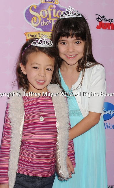 "BURBANK, CA - NOVEMBER 10: Aubrey Anderson-Emmons and Chloe Noelle arrive at the Disney Channel's Premiere Party For ""Sofia The First: Once Upon A Princess"" at the Walt Disney Studios on November 10, 2012 in Burbank, California."
