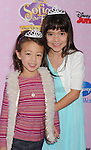 """BURBANK, CA - NOVEMBER 10: Aubrey Anderson-Emmons and Chloe Noelle arrive at the Disney Channel's Premiere Party For """"Sofia The First: Once Upon A Princess"""" at the Walt Disney Studios on November 10, 2012 in Burbank, California."""