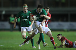 Wales centre Steffan Hughes slows down Tom Daly..Under 20 Six Nations.Wales v Ireland.Eirias - Colwyn Bay.01.02.13.©Steve Pope