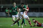 Wales centre Steffan Hughes slows down Tom Daly..Under 20 Six Nations.Wales v Ireland.Eirias - Colwyn Bay.01.02.13.©Steve Pope