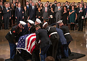 As members of the Bush family look on, the casket containing the remains of former United States President George H.W. Bush is set on the Lincoln Catafalque in the Rotunda of the US Capitol during the ceremony honoring the former President, who will Lie in State in the Rotunda of the US Capitol on Monday, December 3, 2018.<br /> Credit: Ron Sachs / CNP<br /> (RESTRICTION: NO New York or New Jersey Newspapers or newspapers within a 75 mile radius of New York City)