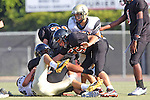 Beverly Hills, CA 09/23/11 - Andrew Phillips (Peninsula #11), Rory Hubbard (Peninsula #33) and unknown Beverly Hills player(s) in action during the Peninsula-Beverly Hills frosh football game at Beverly Hills High School.