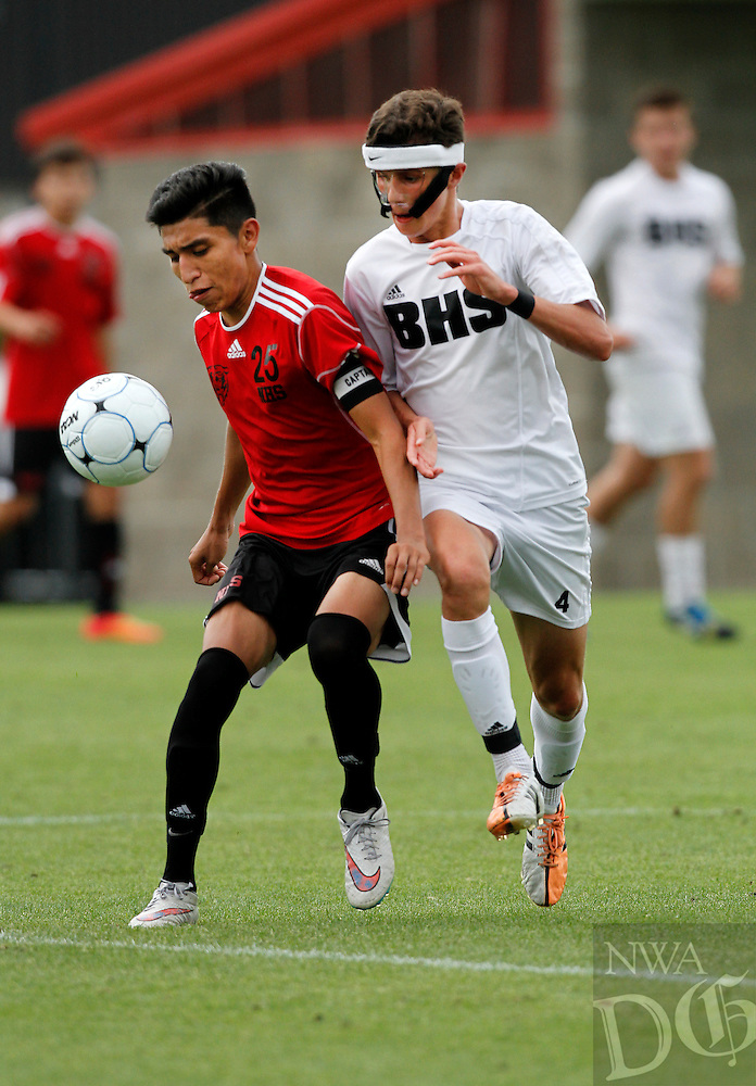 PHOTO BY SAMANTHA BAKER<br /><br />Jesus Manharez, left, of Fort Smith Northside, attempts to keep Wyatt D'Spain of Bentonville away from the ball Saturday, May 23, 2014, for the 7A State Soccer championship at <br />Razorback Field in Fayetteville.