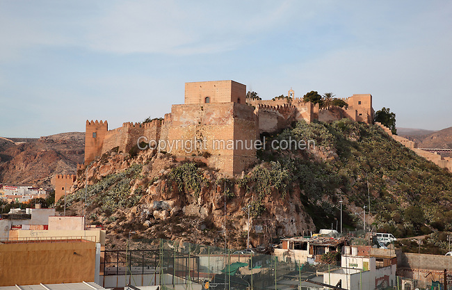 The hilltop Alcazaba, a 10th century fortified enclosure and royal residence in Almeria, Andalusia, Southern Spain. The Alcazaba was begun in 955 by Rahman III and completed by Hayran, Taifa king of Almeria, in the 11th century. It was later added to by the Catholic monarchs. Picture by Manuel Cohen
