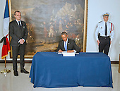 "United States President Barack Obama signs a book of condolence to honor those killed in the terrorist attack on the offices of Charlie Hebdo magazine in Paris, France yesterday at the Embassy of France in Washington, D.C. on Thursday, January 8, 2014.  The President's inscription reads ""On behalf of all Americans, I extend our deepest sympathy and solidarity to the people of France following the terrible terrorist attack in Paris.  As allies across the centuries, we stand united with our French brothers to ensure that justice is done and our way of life is defended.  We go forward together knowing that terror is no match for freedom and ideals we stand for - ideals that light the world.<br /> Vive la France!""  At left is Ambassador Gerard Araud of France.<br /> Credit: Ron Sachs / Pool via CNP"