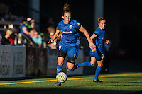 Seattle, Washington - Saturday, July 2nd, 2016: Seattle Reign FC defender Rachel Corsie (4) looks for a pass during a regular season National Women's Soccer League (NWSL) match between the Seattle Reign FC and the Boston Breakers at Memorial Stadium. Seattle won 2-0.
