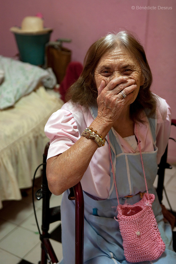 Reynita, a resident of Casa Xochiquetzal, in her bedroom at the shelter in Mexico City, Mexico on May 13, 2009. Casa Xochiquetzal is a shelter for elderly sex workers in Mexico City. It gives the women refuge, food, health services, a space to learn about their human rights and courses to help them rediscover their self-confidence and deal with traumatic aspects of their lives. Casa Xochiquetzal provides a space to age with dignity for a group of vulnerable women who are often invisible to society at large. It is the only such shelter existing in Latin America. Photo by Bénédicte Desrus