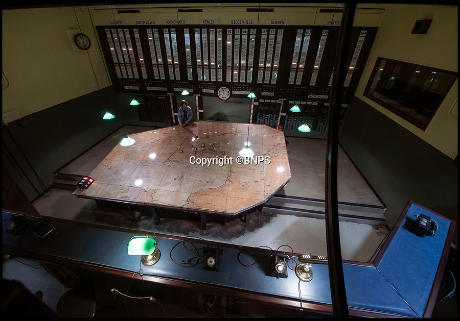 BNPS.co.uk (01202 558833)<br /> Pic: PhilYeomans/BNPS.<br /> <br /> Churchill eye view of the 11 Group control room from where 'The Few' took on the might of Goerings Luftwaffe in 1940.<br /> <br /> The historic room from which the Battle of Britain was won has opened to the public after Hillingdon council acquired the site from the RAF.<br /> <br /> The defence of the capital and much of southern England was conducted from 11 Group control room at RAF Uxbridge during the dark days of 1940 and later the air support for the D-Day landings in June 1944.<br /> <br /> And Churchill even came up with his 'Never in the field of human conflict was so much been owed by so many to so few' on climbing the stairs out of the concrete bunker after witnessing a ferocious days fighting at the height of the Battle in August 1940.<br /> <br /> The new visitor centre is now fully open to the public after a multi million pound redevelopment that recreates exactly the control room at 11.30am on the 15th September 1940...Battle of Britain day.