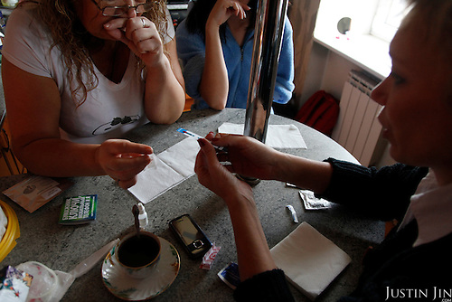 Irina (RIGHT), HIV activist, tests the blood of sex workers in St Petersburg.