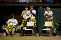 Savannah Bananas coaches (L-R) Corey Pye, Tyle Hankins, Errick Fox, and Phill Shallenberger during a Coastal Plain League game against the Macon Bacon on July 15, 2020 at Grayson Stadium in Savannah, Georgia.  Savannah wore kilts for their St. Patrick's Day in July promotion.  (Mike Janes/Four Seam Images)